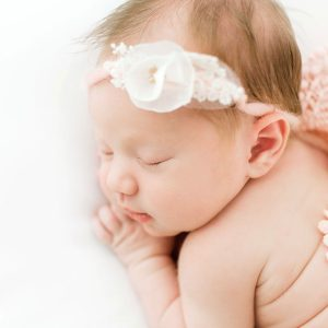 newborn baby girl with pink wrap