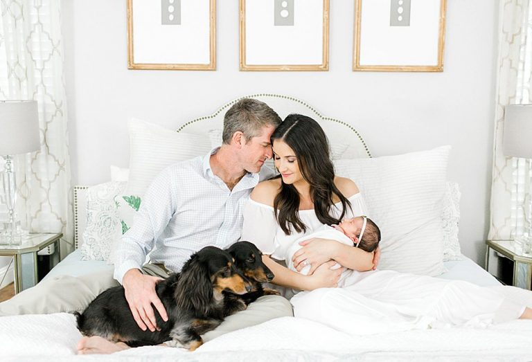 Family with newborn baby and dogs