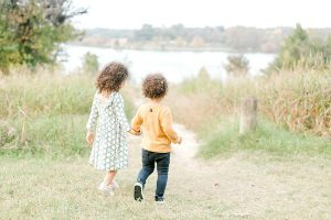 Siblings holding hands at White Rock Lake